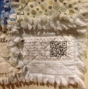 Printed quilt label with corresponding qr code and shortened link.